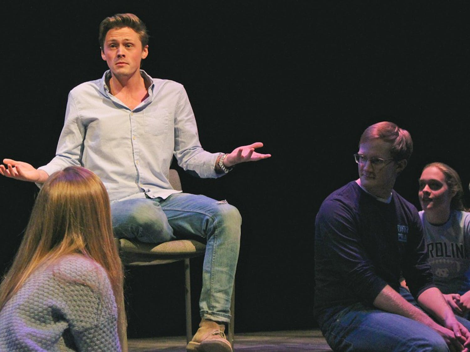 """Christian Payne, a senior dramatic arts and English major, performs """"Just Friends"""" during the UNC-Duke collaboration, the Me Too Monologues."""