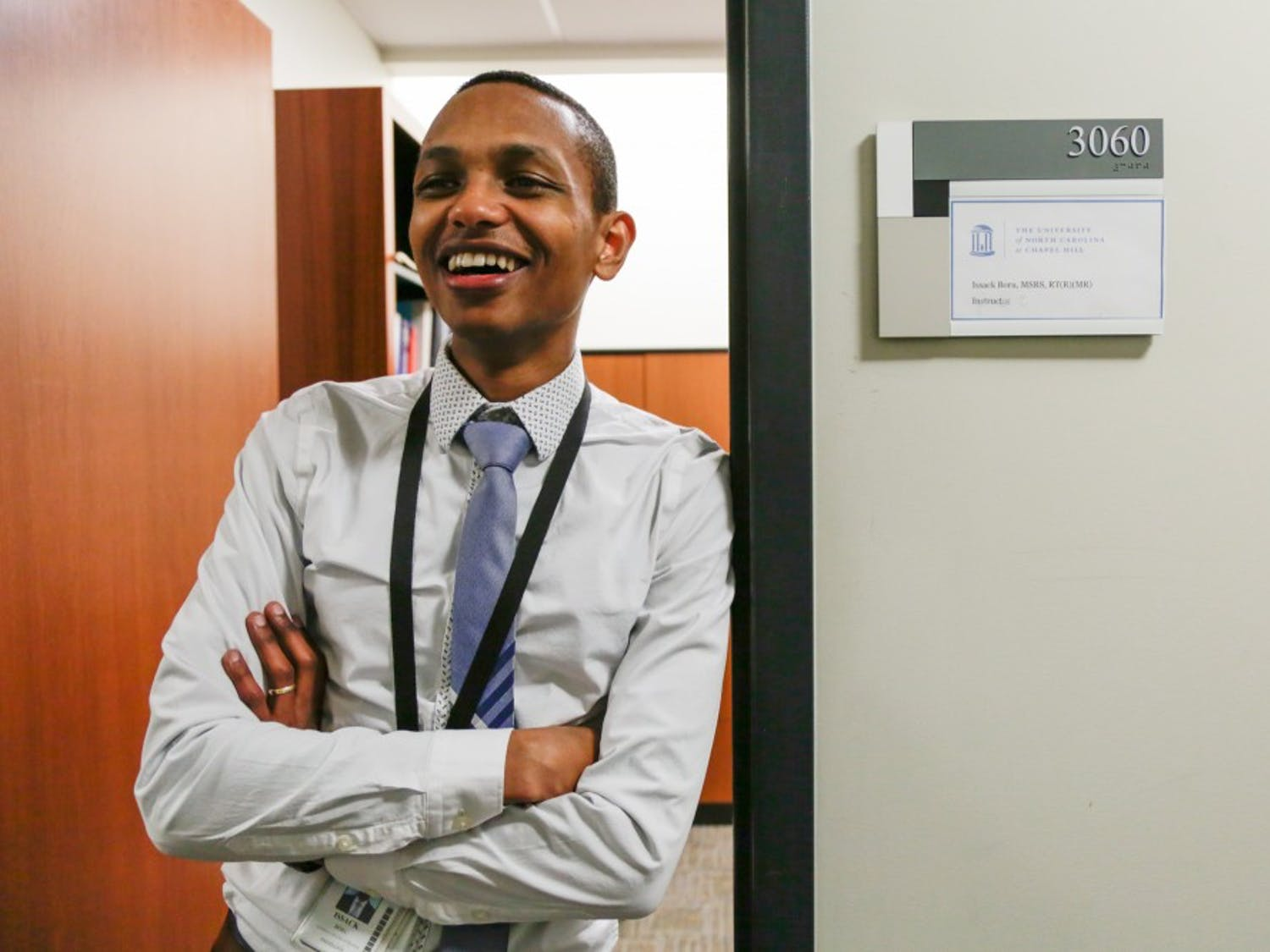 Issack Boru, radiology imaging supervisor and clinical instructor for the Division of Radiologic Science, poses in the door to his office in Bondurant Hall, home to the UNC School of Medicine, Tuesday, Feb. 19, 2019. Boru traveled with RAD-AID international in 2018 to partner with and teach radiologists at Tikur Anbessa Specialized Hospital (TASH) in Addis Ababa, Ethiopia.