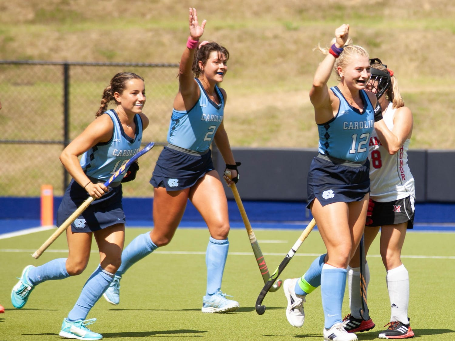 UNC players cheer after a successful goal during the field hockey game against the Miami Redhawks at Karen Shelton Stadium on Sept. 19, 2021. The Tar Heels defeated the Redhawks 7-2.