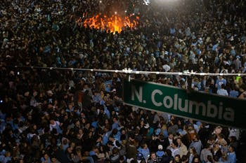 UNC students rush the intersection of Franklin and Columbia Streets after a men's basketball win against Duke on Wednesday, Feb. 21, 2019. The Tar Heels won against the Blue Devils 88-72.