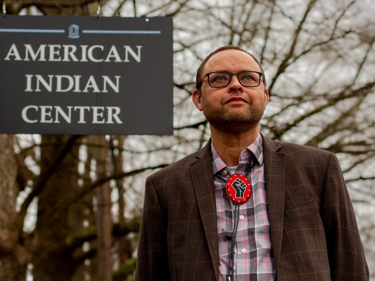 """Dr. Larry Chavis, director of the UNC American Indian Center, poses for a portrait in Chapel Hill on Monday, Mar. 1, 2021. Chavis, who is a member of the Lumbee Tribe of North Carolina, notes the importance of belonging and of doing so """"on your own terms."""""""
