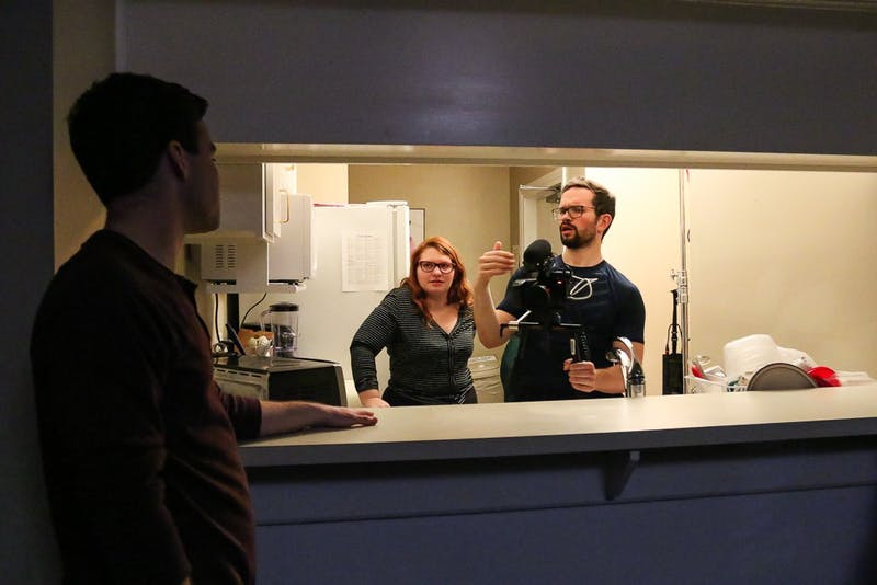 (From left) Junior communication and dramatic arts major Matthew Keith, CFA president junior Julia Stamey, and junior computer science and communications major Michael Sparks discuss a scene on the set of a project on Friday, Feb. 7, 2020.