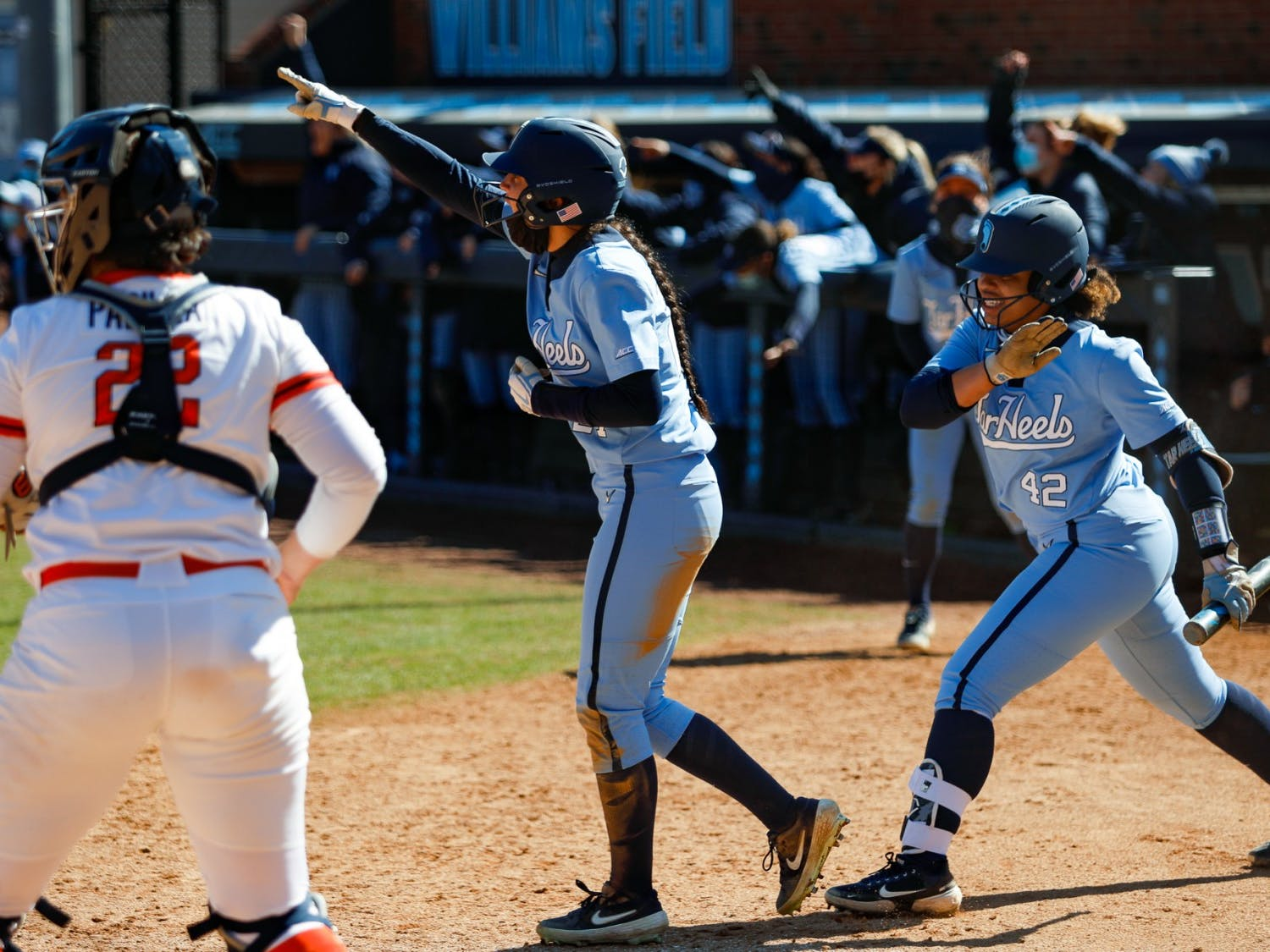 UNC sophomore outfielder Bri Stubbs (27) and junior pitcher Hannah George (42) celebrate after scoring two runs to tie the game in Anderson Softball Stadium in Chapel Hill, NC on Feb. 20, 2021. The Syracuse Orange beat the Tar Heels 3-2.