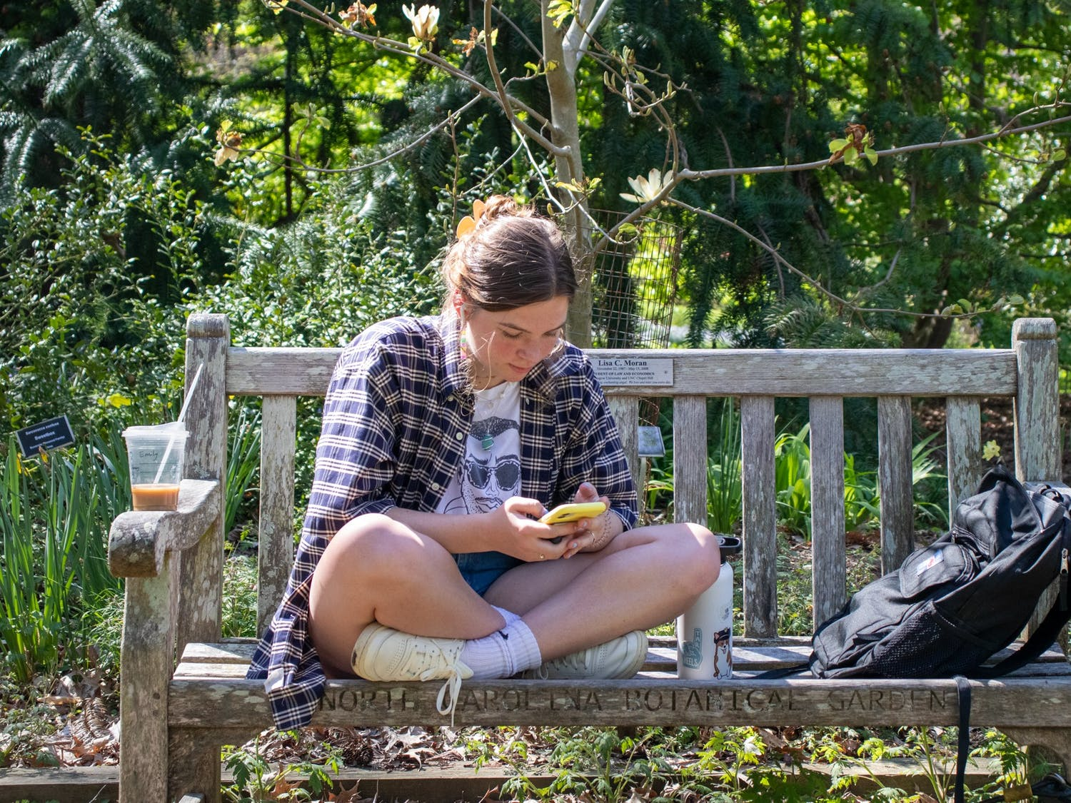 UNC sophomore psychology major Emily Cushing sits in Coker Arboretum in Chapel Hill on April 5, 2021.