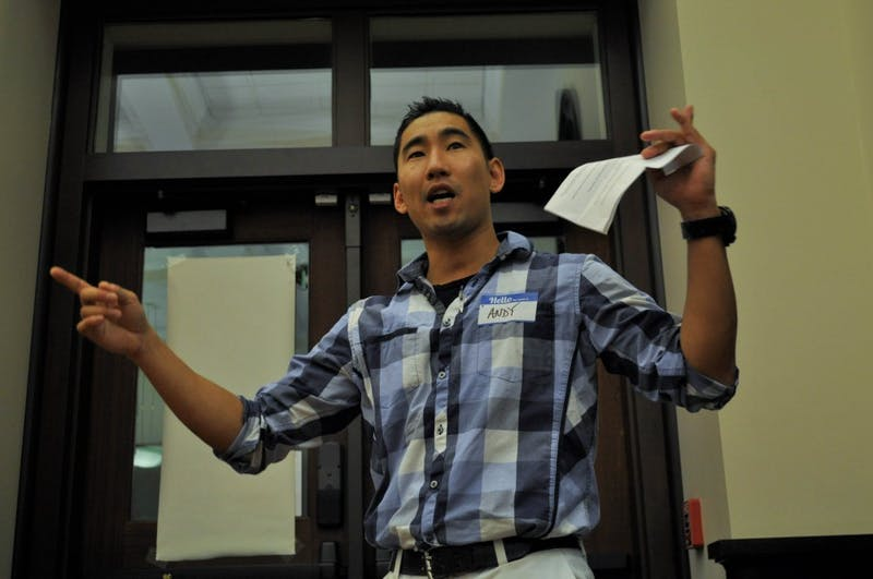Andrew Garbisch, a fourth year graduate student, speaks during an open forum hosted by the Asian American Center Student Advisory Board at Campus Y's Anne Queen Lounge on Thursday, Oct. 24, 2019. The forum featured discussions about establishing an Asian American Center on campus and stories from community members about what an Asian American Center would mean to them.