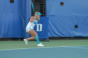 Sophomore Makenna Jones returns a serve against Duke on April 20  at the Ambler Tennis Center in Durham.