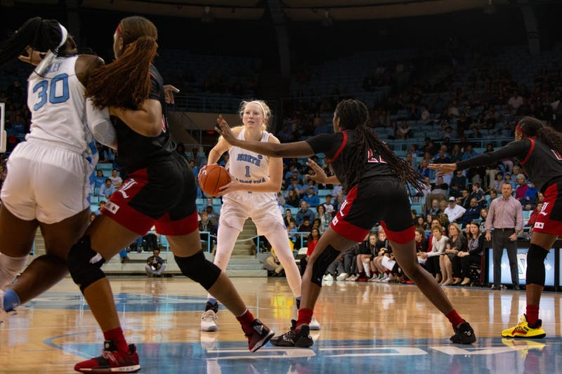 Senior guard Taylor Koenen Bennett (1) prepares to pass the ball in the game against Louisville at Carmichael Arena on Sunday, Jan. 19, 2020. UNC lost 67-74.