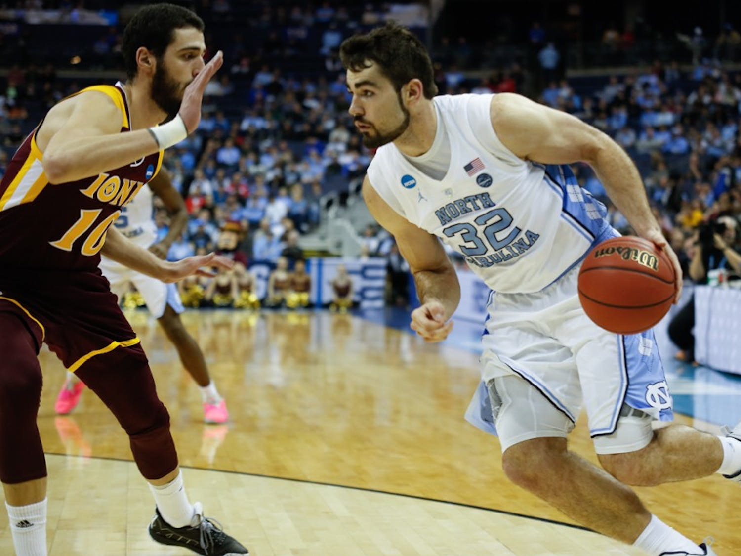 Senior forward Luke Maye (32) drives past Iona player on Friday, March 22, 2019 during the first round of the NCAA Championship at Nationwide Arena in Columbus, Ohio.