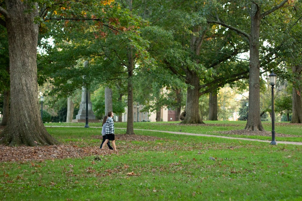 <p>UNC students stroll through McCorkle place on North Campus on Tuesday, Oct. 27th, 2020.</p>