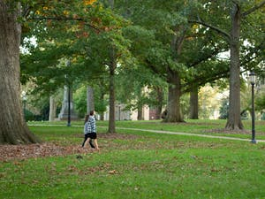 UNC students stroll through McCorkle place on North Campus on Tuesday, Oct. 27th, 2020.