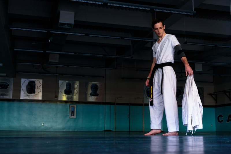 Senoir psychology and peace, war, and defense major Brandon Kelly grew averted to martial arts after his injured elbow cost him his judo match at the olympic trials. His experience studying abroad helped him find catharsis.