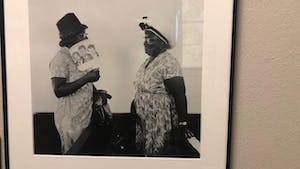 """A photo titled """"Women talking after church service at Hunter Chapel Missionary Baptist Church, 1971."""" The photo is part of the exhibit of Cheryl Thurber photos being hosted by Wilson Library, detailing musical traditions in Gravel Springs, Mississippi."""