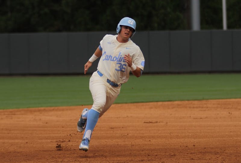 Ashton McGee runs to 3rd off a hit. UNC men's baseball team played Elon on Tuesday night, April 25, 2017.