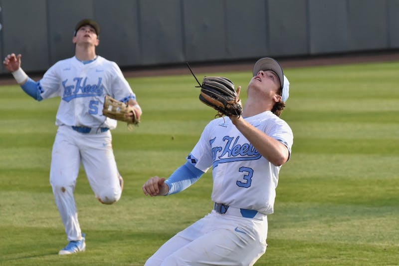 Junior Kyle Datres (3) prepares for a catch against UNC-Wilmington on Feb. 20 at Boshamer Stadium.