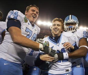 Casey Barth is all smiles after his game-winning field goal gave UNC a 30-27 victory against Tennessee in the Music City Bowl in Nashville.
