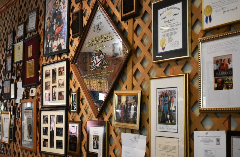 The walls at Mama Dip's Kitchen on Rosemary St. are decorated with photographs, awards, and articles about the restaurant.
