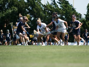 North Carolina and Navy players fight for the ball during a NCAA quarterfinal match on May 20, 2017, at Fetzer Field.