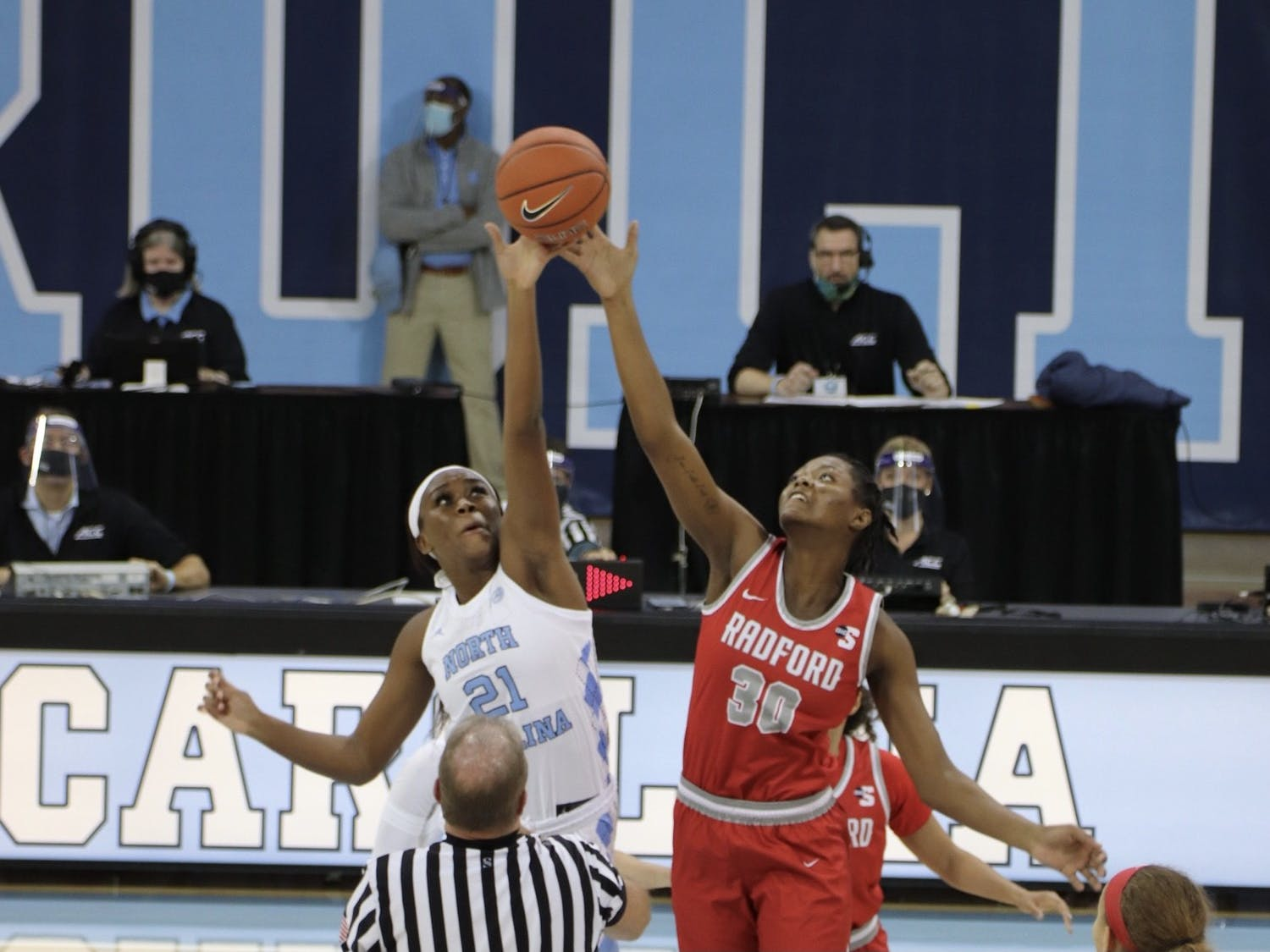 UNC sophomore forward Malu Tshitenge (21) goes up against Radford sophomore center Taiye Johnson (30) during a game in Carmichael Arena on Wednesday, Nov. 25, 2020. UNC beat Radford 90-61.