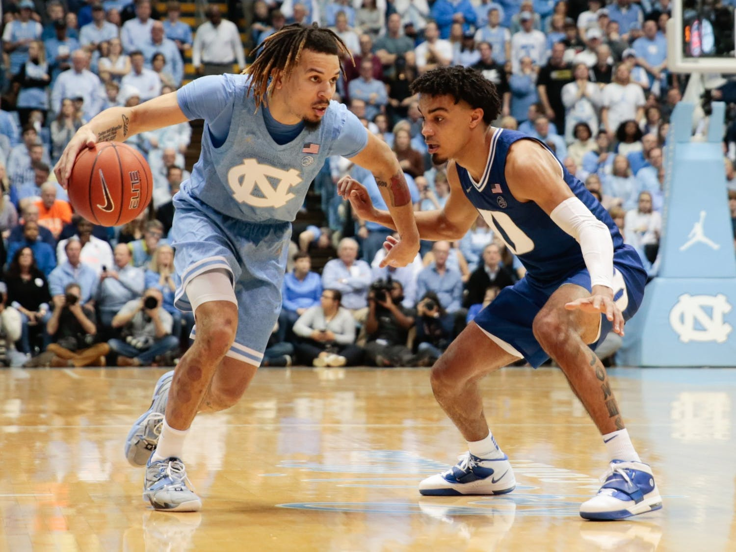 UNC first-year guard Cole Anthony runs the ball upcourt past Duke sophomore guard Tre Jones during a game in the Smith Center during Saturday, Feb. 8, 2020. The Tar Heels lost tot he Blue Devils 98-96.