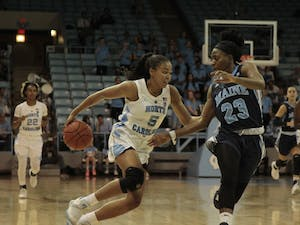 UNC junior guard Stephanie Watts (5) protects the ball against Maine senior guard Tanesha Sutton (23) during the game against Maine on Sunday, Dec. 2, 2018. UNC lost to Maine 85-73. Watts scored 16 points.