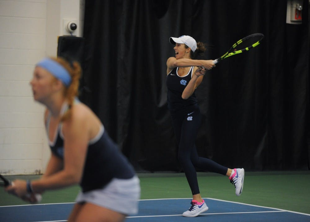 UNC women's tennis first-year Cameron Morra returns in a doubles match alongside Sara Daavettila against Florida State University at Cone-Kenfield Tennis Center on Friday, Apr. 5, 2019. The No. 2 UNC women's tennis team beat No. 13 FSU 4-0.