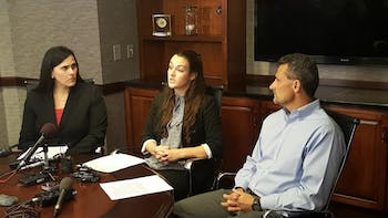 Delaney Robinson (center), with her attorney Denise W. Branch and her father, Stacey Robinson, earlier today at her press conference.