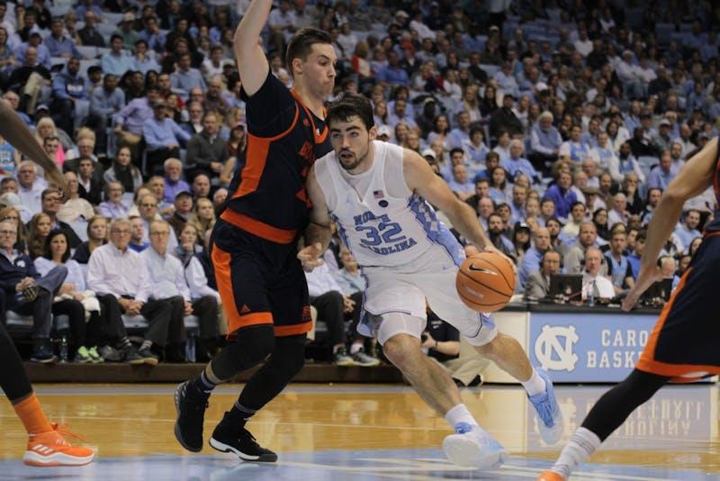 Forward Luke Maye (32) attacks the basket against Bucknell on Nov. 15 in the Smith Center.