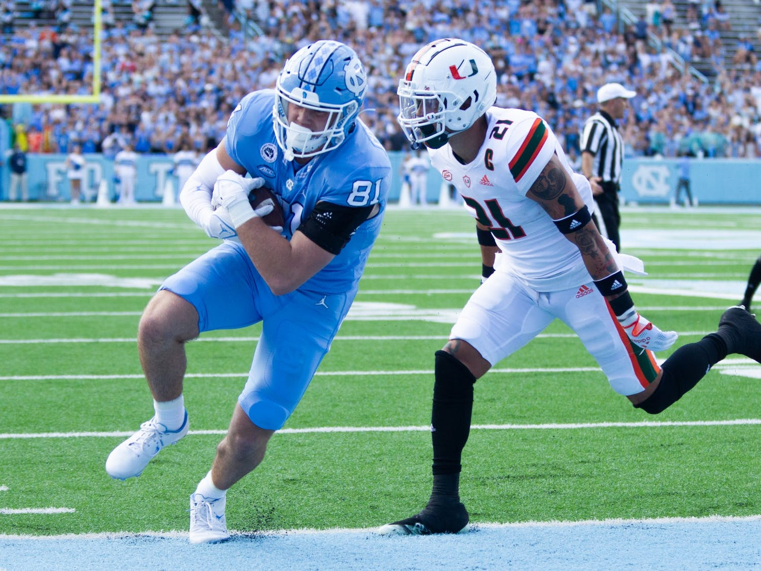 Redshirt first-year tight end John Copenhaver (81) scores a touchdown at the game against Miami on Oct. 16 at Kenan Stadium. UNC won 45-42.