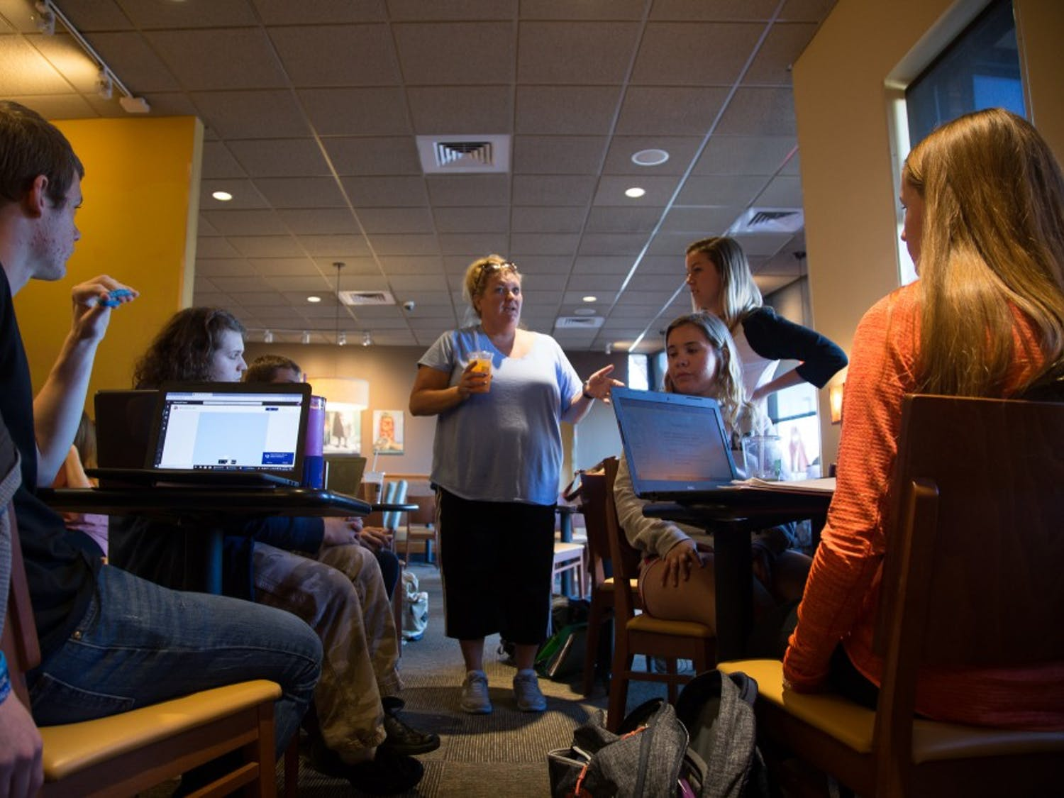 AP Biology teacher at White Oak High School, Tayna Larose, lectures to her AP BioStats combined class at Panera on Oct. 29, 2018. White Oak High School was closed for 35 days due to flooding from Hurricane Florence. Many teachers offered pop-up classes and tutoring in places varying from Panera to churches across the town.