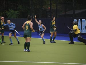 Forward Marissa Creatore (33) celebrates after assisting Catherine Hayden (8) in scoring UNC's third goal against William & Mary during the first round of the NCAA Tournament in Karen Shelton Stadium Friday. UNC field hockey advances to the second round of the NCAA Tournament after defeating William & Mary 4-0.