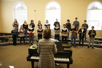 Susan Klebanow, the director of choral activities at UNC, directs the UNC Chamber Singers in preparation for a concert to celebrate 100 years of UNC's music department.