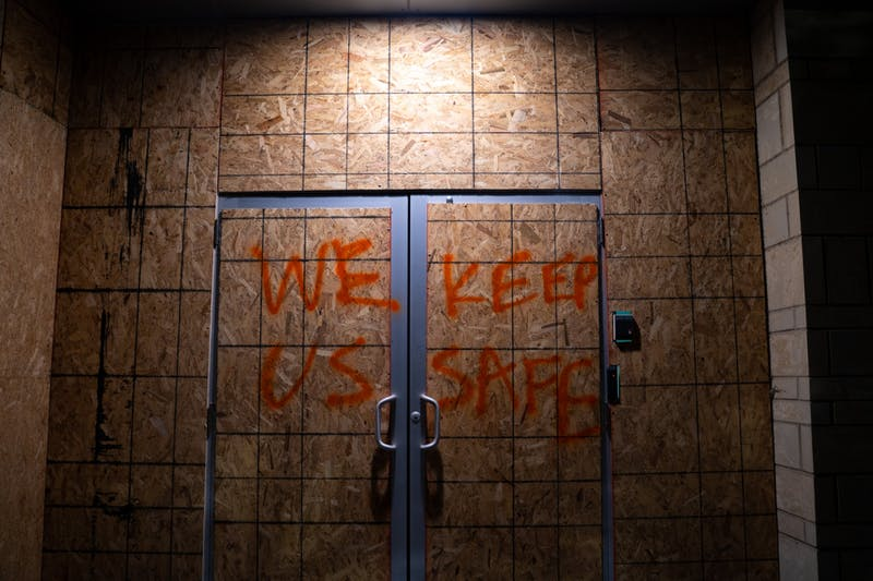 """Spray paint on a boarded-up building in downtown Raleigh during the Black Lives Matter protest on Friday, Aug. 28, 2020 reads, """"WE KEEP US SAFE,"""" in reference to the anti-police movement."""