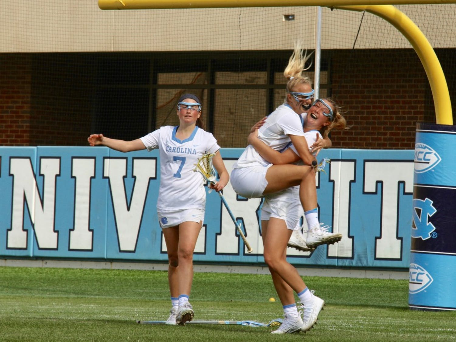 Katie Hoeg (8) leaps into the arms of attacker Jamie Ortega (3), who scored the game-winning goal against Maryland on Feb. 24 in Kenan Stadium.