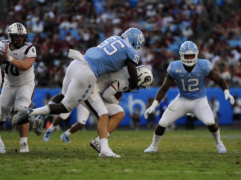 Senior defensive lineman Jason Strowbridge (55) tackles USC's quarterback during the Belk College Kickoff in Charlotte, N.C. on Saturday, August 31, 2019.