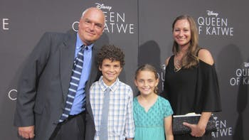 (from left) UNC film professor Tim Crother, his son, Atticus, daughter, Sawyer, and wife, Candace, pose at the premiere of the new Disney movie Queen of Katwe in Hollywood. Photo Courtesy of Tim Crother.