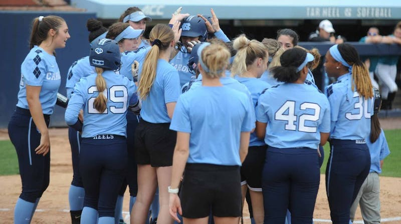 The softball team congratulates junior pitcher Brittany Pickett (28) for hitting a home run during the game against Costal Carolina University on Tuesday, April 9, 2019 at the Anderson Softball Stadium. UNC won 9-0 against Costal Carolina University.