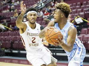 Redshirt freshman guard Anthony Harris (0), makes a pass during Carolina's 82-75 loss at Florida State, January 16, 2021. Photo courtesy of Miguel A. Olivella Jr.
