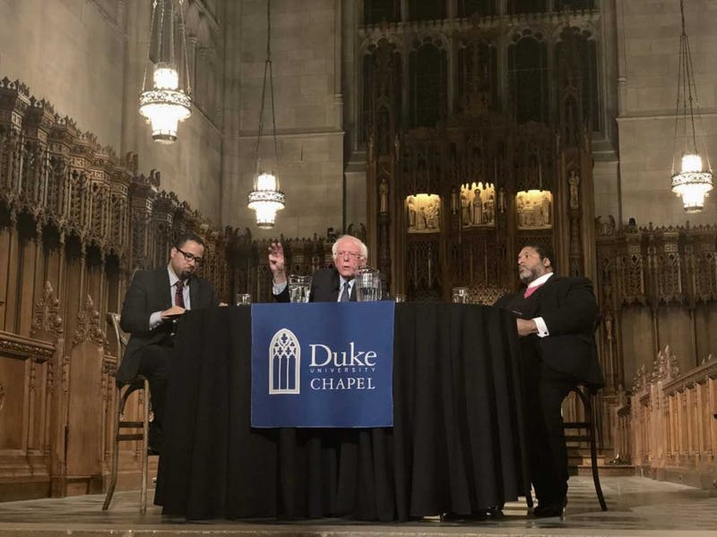 "Duke University Chapel hosted a ""public conversation"" with U.S. Sen. Bernie Sanders, I-VT, and the Rev. William Barber II moderated by Luke Powery Thursday. The three discussed race, poverty and militarism to commemorate Martin Luther King Jr."