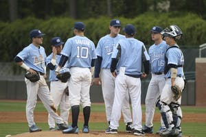 UNC Baseball team gathers on the mound.