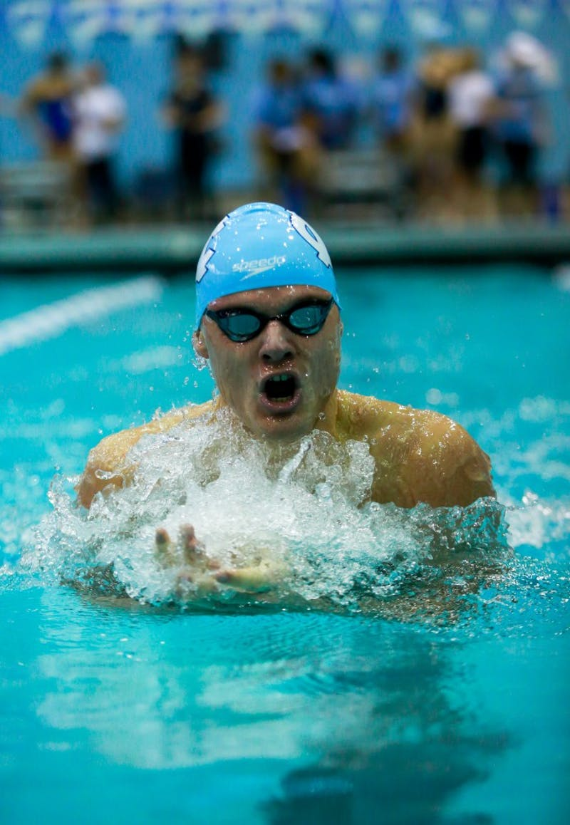 Valdas Abaliksta competes in the 200 yard breaststroke event during the home swim and dive meet vs. Duke in Koury Natatorium on Saturday, Feb. 2, 2019.