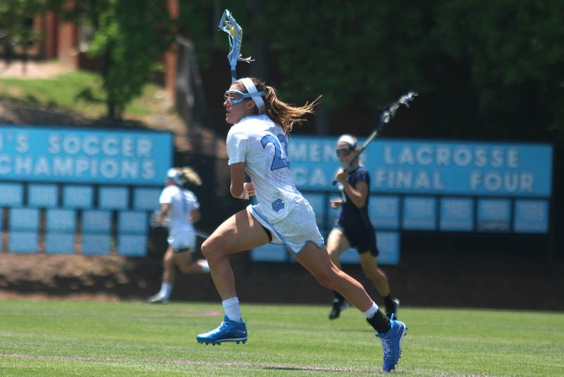Taylor George charges toward the goal during Sunday afternoon's NCAA tournament game against Georgetown.