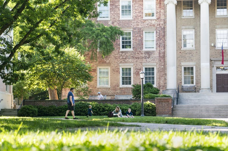 A family picnics on the lawn outside of South Building on Sunday, June 7, 2020.