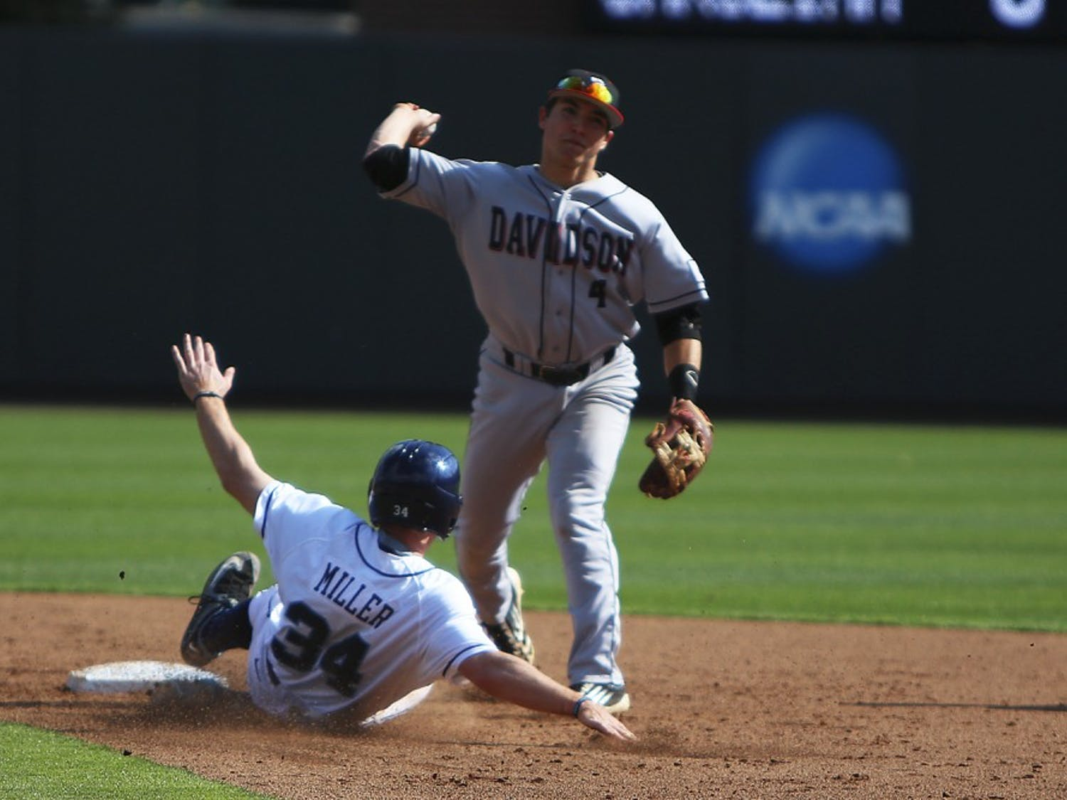 Left fielder Brian Miller (34) slides into second base where he is tagged out.