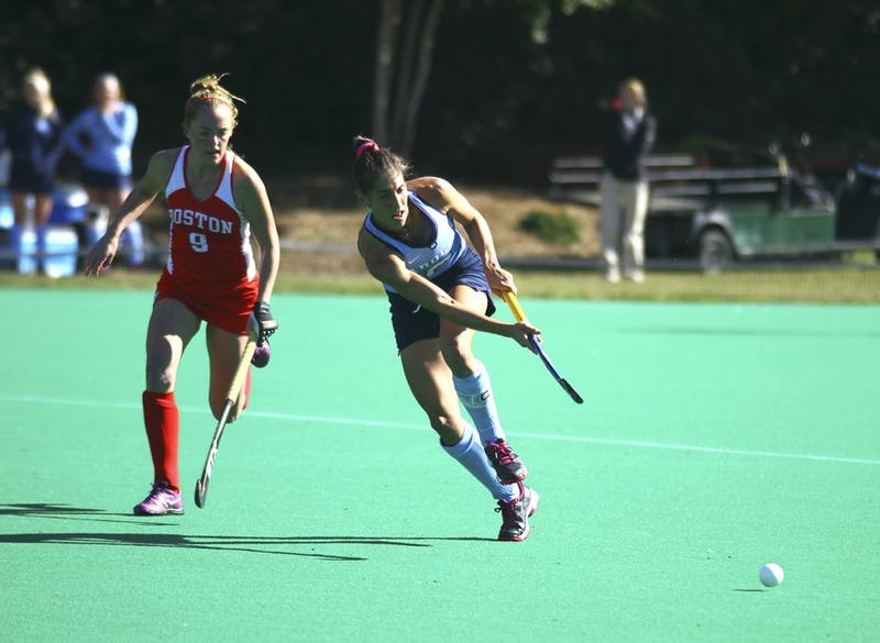 Wold, Emily passes the ball at the field hockey game against Boston University on Saturday Nov. 14