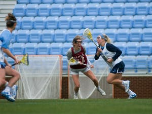 UNC Junior attacker Taylor McDaniels (10) looks for scoring opportunities. The Tar Heels won 20-3 over Elon during the exhibition match on Feb. 1, 2020, at Dorrance Field.