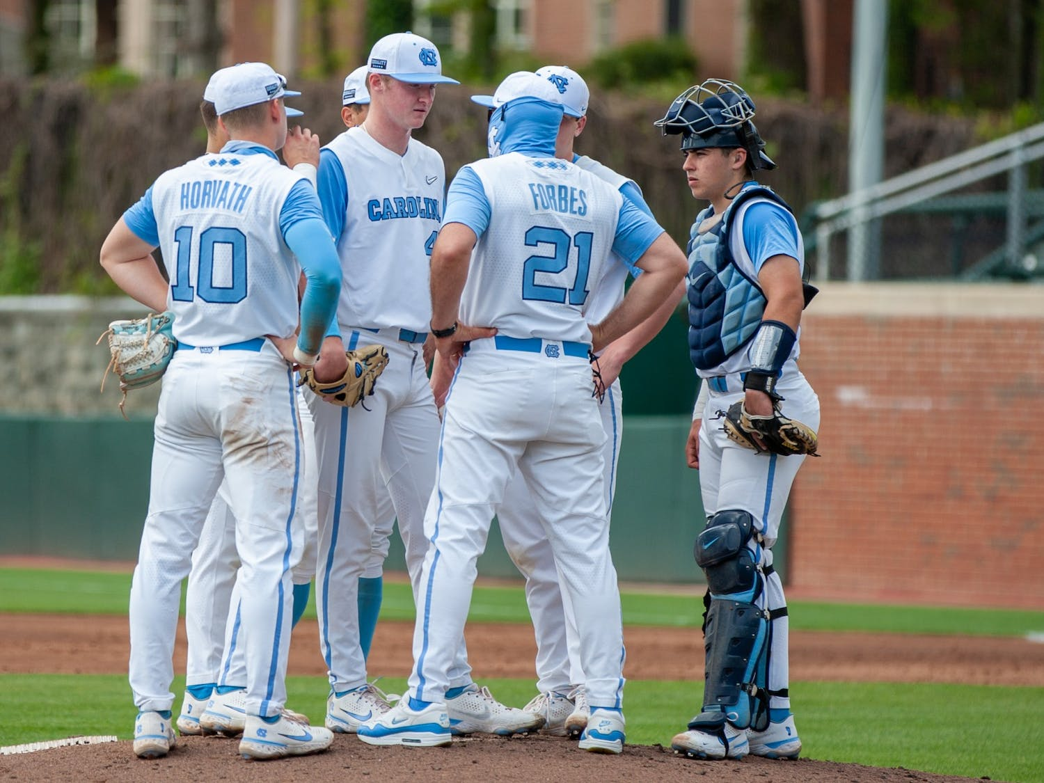 UNC baseball's Head Coach Scott Forbes pays a mound visit during the game against Duke on Saturday Apr. 10 2021 at Boshamer stadium. UNC lost 2-4.