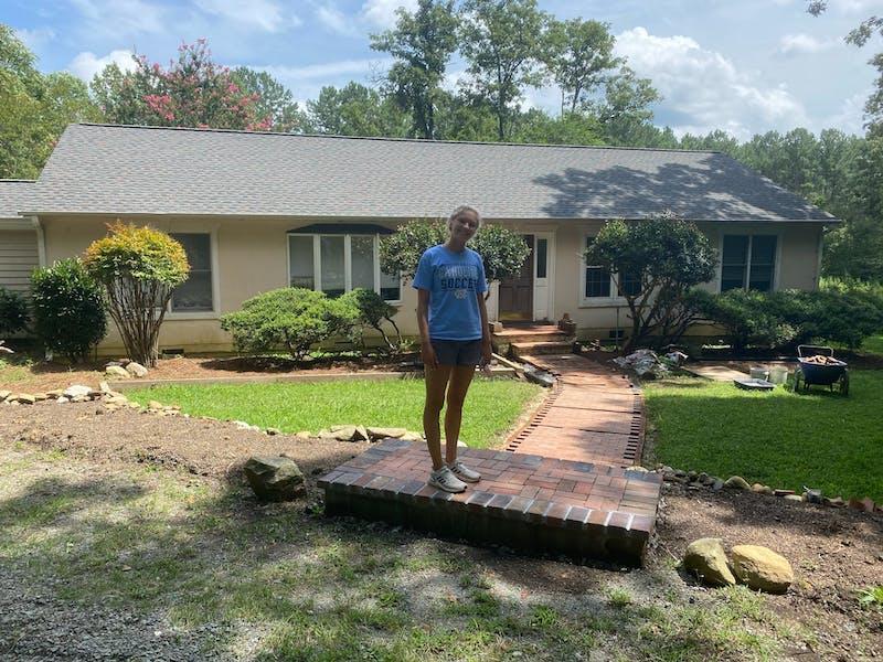 Caroline Parker stands outside of the North Carolina she's living in during her gap semester. Photo courtesy of Caroline Parker.