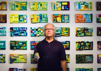George McKim stands in front of his paintings. McKim's work will be featured at the Horace Williams House from Jan. 5 to Feb. 2, 2020. Photo courtesy of George McKim.