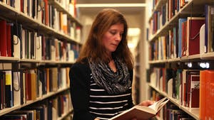 Research instructional services librarian Angela Bardeen helps students find information about their research, narrow down paper topics, and select good sources at Davis Library.