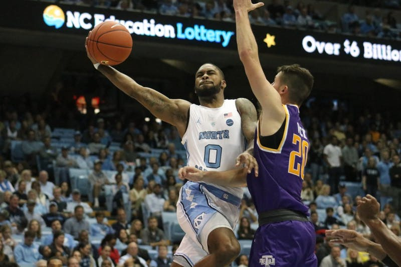 UNC guard Seventh Woods (0) uses his full wingspan in a scoring drive against Tennessee Tech on November 18th in the Dean Dome.